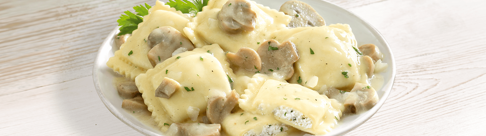 CHEESE RAVIOLI IN MUSHROOM CREAM