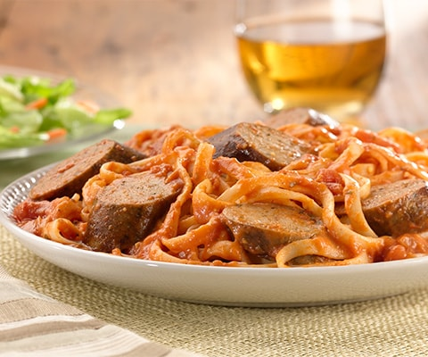 Grilled Sweet Italian Chicken Sausage with Tomato Vodka Sauce over Linguine