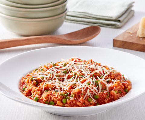 Cauliflower Rice Risotto with Green Peas and Tomato Sauce
